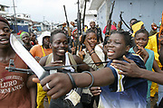 LURD(Lieberians United for Reconciliation and Democracy) rebels celebrate a ceasefire in rebel controlled Freeport, Monrovia 05 August 2003. A ceasefire is delicately in place as journalists crossed to the LURD occupied Freeport for the first time since fighting broke out, today to be met with jubilant rebels who were struggling to control looting in the area.<br /> EPA PHOTO/NIC BOTHMA