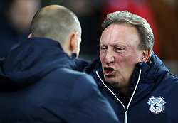 Cardiff City manager Neil Warnock (right) and Preston North End manager Alex Neil prior to the Sky Bet Championship match at The Den, London.