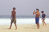Boys flying kites on Ipanema Beach