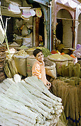 boy smiling in market, India