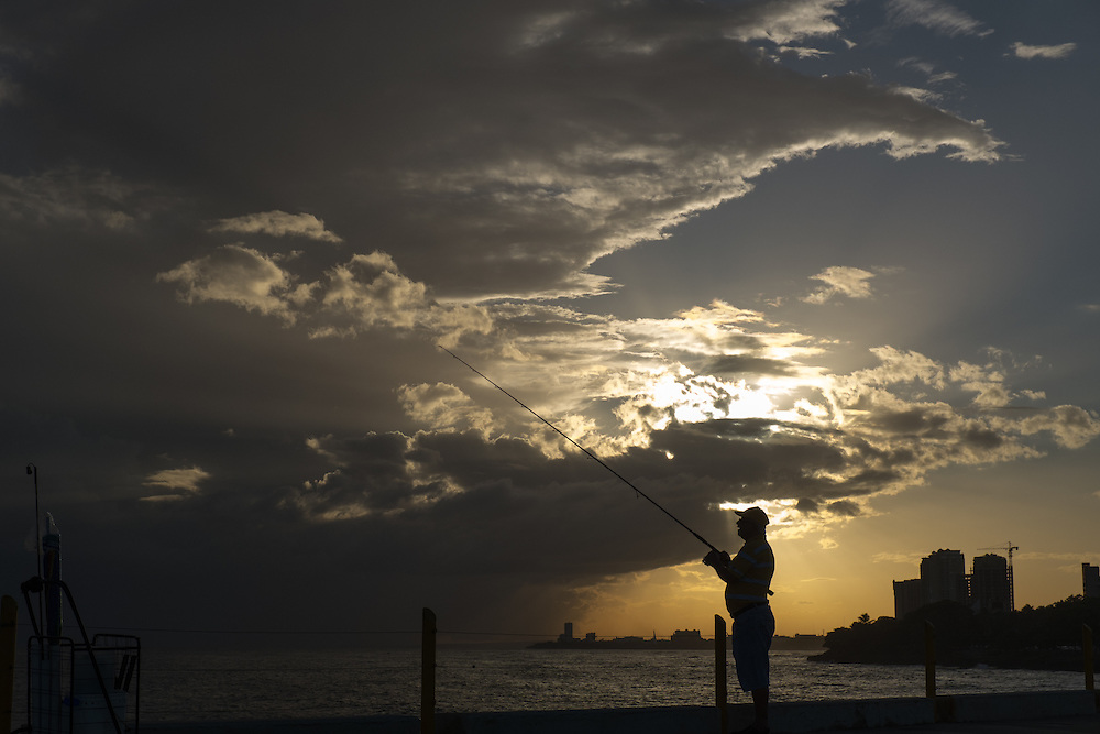 SANTO DOMINGO, DOMINICAN REPUBLIC-DECEMBER 2, 2014: A man fishes near a park in Santo Domingo's Malecon at sundown. Story on tourism to the Caribbean Island. (Photo by Angel Valentin/Getty Images for Der Spiegel)