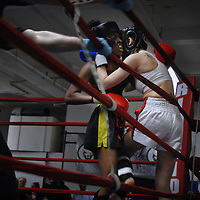 Angelica Ferguson (right) fights of an attack from Sarah Johnson. Women are increasing being drawn to mixed martial arts competitions.