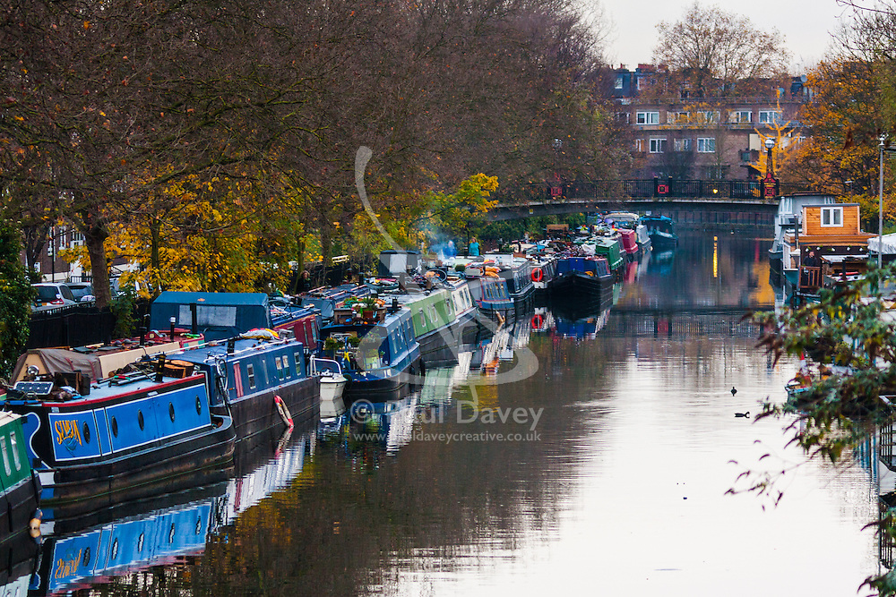Paddington Basin, London, November 25th 2014. Smoke rises from a chimney on a canal boat on the Grand Union Canal near Paddington.