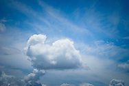 White puffy clouds in bright blue sky