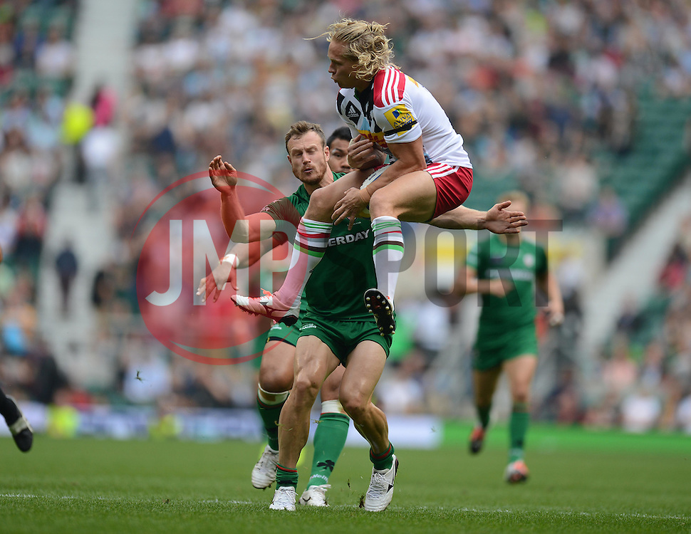 London Irish Winger James Short looks to tackle Harlequins Outside Centre Matt Hopper as he catches the ball.- Photo mandatory by-line: Alex James/JMP - 07966 386802 - 06/09/2014 - SPORT - RUGBY UNION - London, England - Twickenham Stadium - Saracens v Wasps - Aviva Premiership London Double Header.