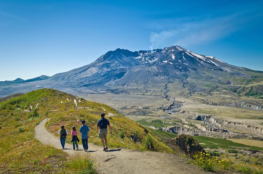 Mount Saint Helens and family hiking on Boundary Trail #1 at Johnston Ridge; Mount St. Helens National Volcanic Monument, Washington.