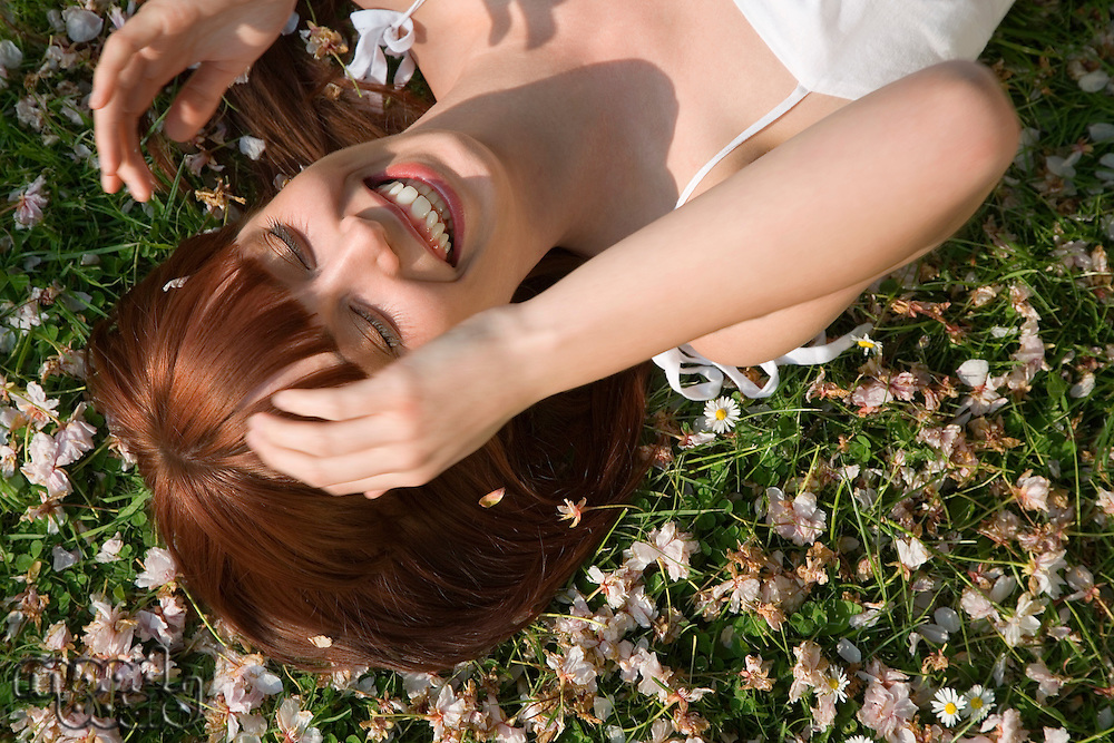 Laughing Woman Lying in the Grass
