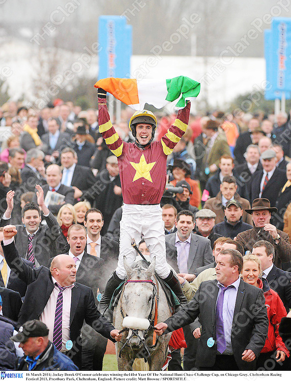 16 March 2011; Jockey Derek O'Connor celebrates winning the141st Year Of The National Hunt Chase Challenge Cup, on Chicago Grey. Cheltenham Racing Festival 2011, Prestbury Park, Cheltenham, England. Picture credit: Matt Browne / SPORTSFILE