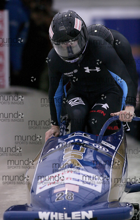 (November 21, 2009)John Napier (front) and Charles Napier push the USA 2 sled at the start of the first run. They finished first at the Federation Internationale de Bobsleigh et de Togogganing (FIBT) two-man men's bobsled World Cup race at the Olympic Sports Complex in Lake Placid, New York.