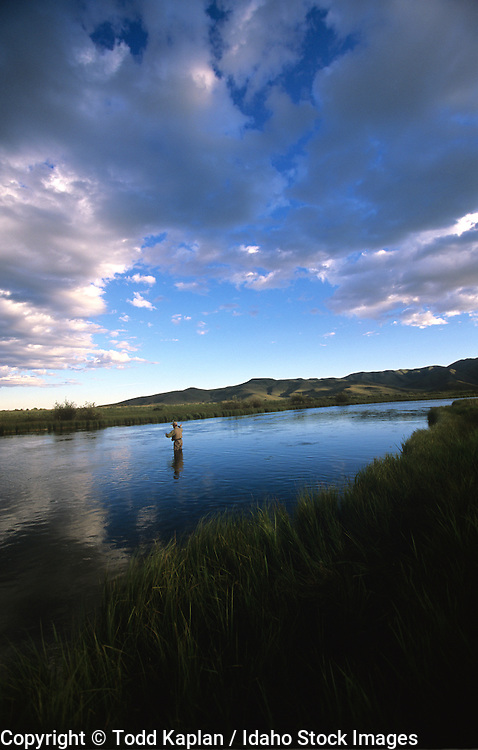 Idaho, Silver Creek, Spring Creek, Fly Fishing, fisherman, summer, storm clouds, man casting, late afternoon,