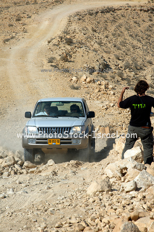 Israel, northern plains Negev desert, 4 wheel drive challange an instructor is guiding the driver