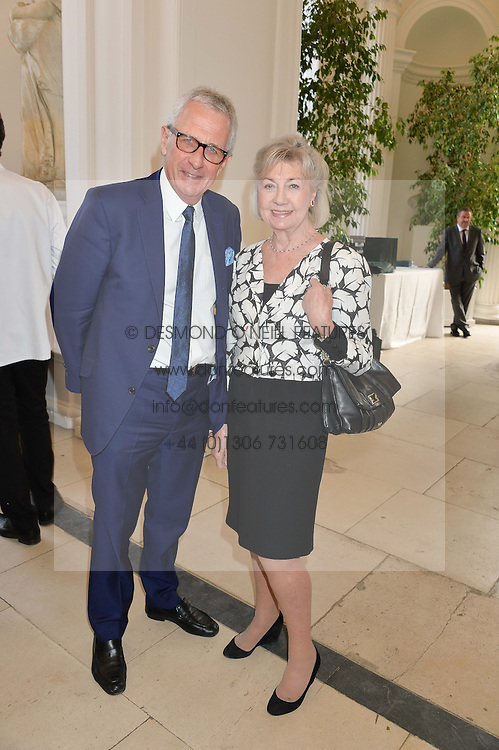ROBERT LACEY and his wife LADY JANE LACEY at a party to celebrate the 150th anniversary of Wartski held at The Orangery, Kensington Palace, London, on 19th May 2015.