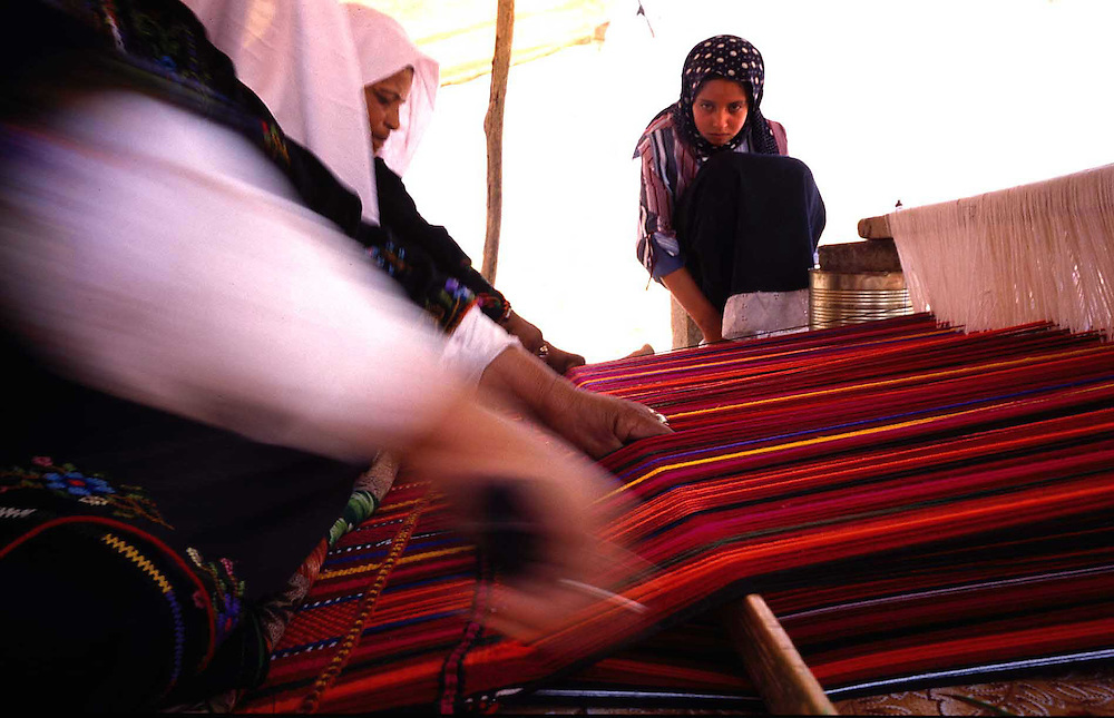 Bedouin mom instruct here young daughter the needlework?s that every Bedouin woman know...It start when the girl get to age of 10, than she start to needlework?s here weeding dress. ..