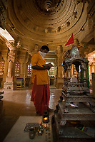 jain priest praying temple of lodruva jaisalmer in rajasthan state in india