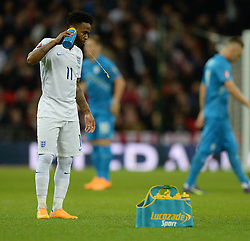 Raheem Sterling of England (Liverpool) spits out his drink prior to kick off. - Photo mandatory by-line: Alex James/JMP - Mobile: 07966 386802 - 15/11/2014 - SPORT - Football - London - Wembley - England v Slovenia - EURO 2016 Qualifier