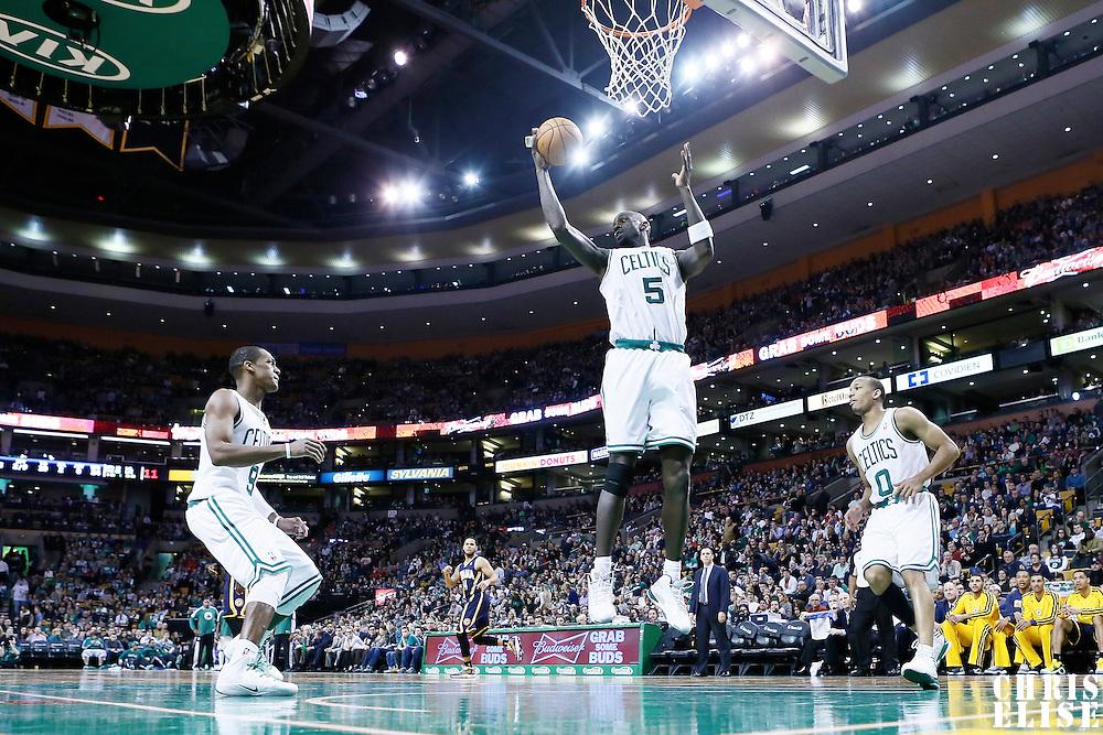04 January 2013: Boston Celtics power forward Kevin Garnett (5) grabs a rebound next to Boston Celtics point guard Rajon Rondo (9) and Boston Celtics point guard Avery Bradley (0) during the Boston Celtics 94-75 victory over the Indiana Pacers at the TD Garden, Boston, Massachusetts, USA.