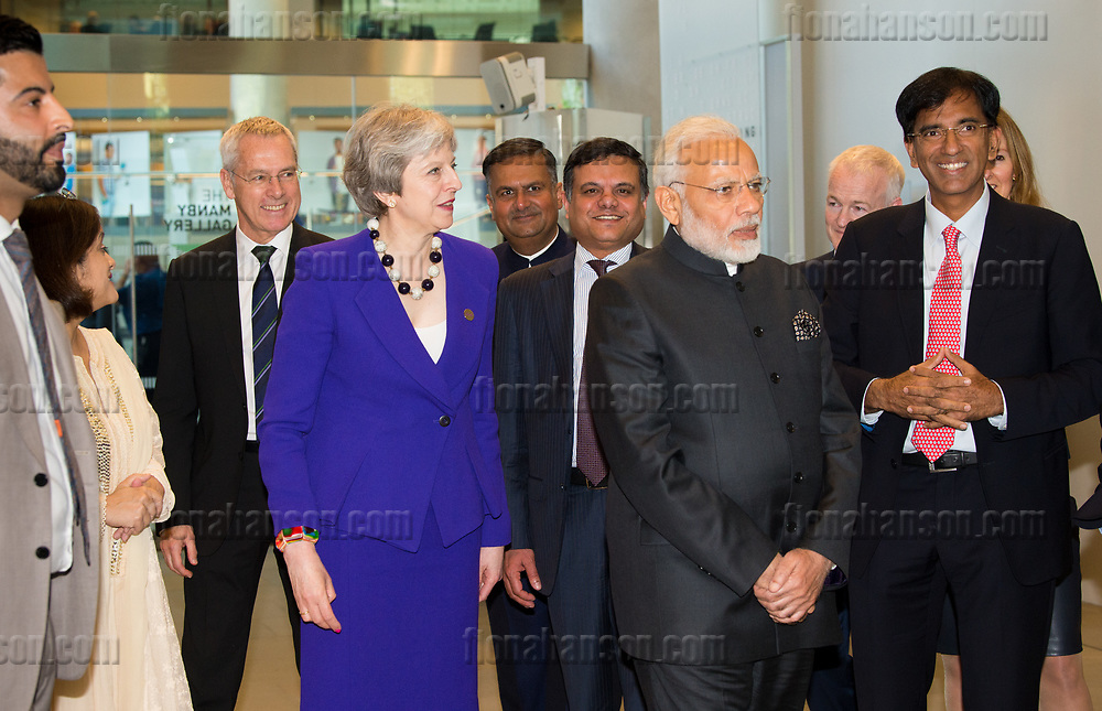 20180418       Copyright image 2018&copy;<br /> <br /> UK Prime Minister, Theresa May and the Prime Minister of India, Narendra Modi, visit  The Francis Crick Institute, London on Wednesday 18 April 2018 to learn about the latest cancer and malaria research that the institute are spearheading. The visit came as the two leaders launched a new UK-India Tech Partnership today.  They also announced &pound;1 billion in commercial deals.<br />  <br /> For photographic enquiries please call Fiona Hanson  07710 142 633 or email info@fionahanson.com <br /> This image is copyright Fiona Hanson 2018&copy;.<br /> This image has been supplied by Fiona Hanson and must be credited Fiona Hanson. The author is asserting her full Moral rights in relation to the publication of this image. All rights reserved. Rights for onward transmission of any image or file is not granted or implied. Changing or deleting Copyright information is illegal as specified in the Copyright, Design and Patents Act 1988. If you are in any way unsure of your right to publish this image please contact Fiona Hanson on07710 142 633 or email info@fionahanson.com