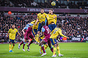 Calum Chambers (Arsenal) heads the ball during the Premier League match between West Ham United and Arsenal at the London Stadium, London, England on 9 December 2019.