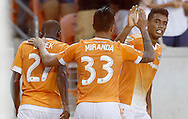 Jun 29, 2016; Houston, TX, USA; Houston Dynamo midfielder Oscar Garcia (27) and midfielder Leonel Miranda (33) celebrate  forward Mauro Manotas (19) second goal of the game in the second half at BBVA Compass Stadium. Dynamo won 3 to 1. Mandatory Credit: Thomas B. Shea-USA TODAY Sports
