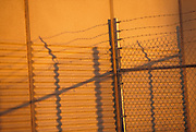 Chain link and barbed wire fencing.