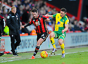 AFC Bournemouth defender Adam Smith and Norwich City midfielder Matthew Jarvis during the Barclays Premier League match between Bournemouth and Norwich City at the Goldsands Stadium, Bournemouth, England on 16 January 2016. Photo by Graham Hunt.