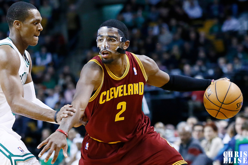 19 December 2012: Cleveland Cavaliers point guard Kyrie Irving (2) drives past Boston Celtics point guard Rajon Rondo (9) during the Boston Celtics 103-91 victory over the Cleveland Cavaliers at the TD Garden, Boston, Massachusetts, USA.