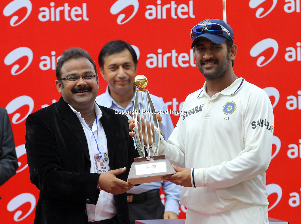 Indian Capatain MS Dhoni receive winning trophey during the 3rd test match day-4 Played at Vidarbha Cricket Association Stadium, Jamtha, Nagpur, 23 November 2010 (5-day match)