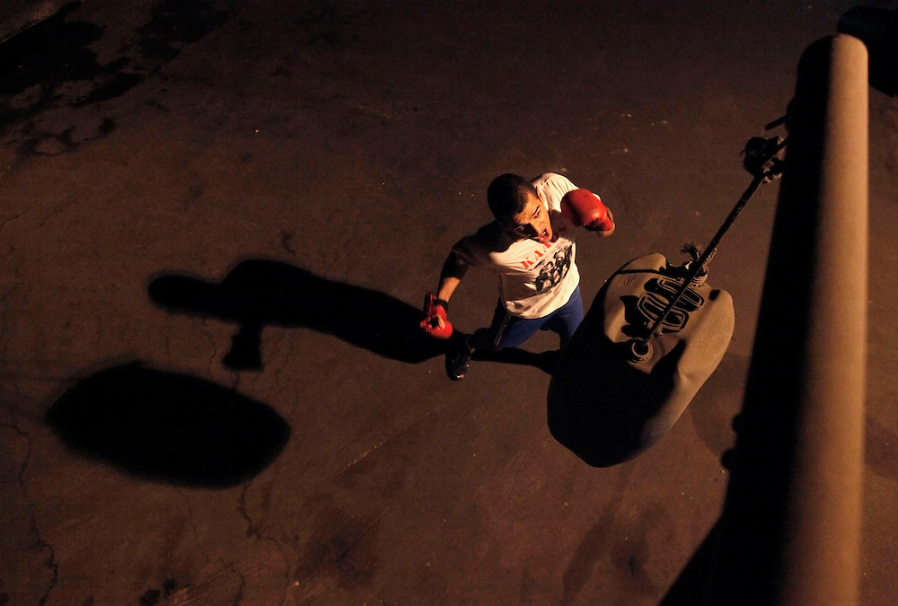 Aspiring boxer Ryan Martins uses a discarded plastic jug as a punching bag during a training session at a gymnasium under the Alcantara Machado viaduct in the Mooca neighborhood of Sao Paulo, March 24, 2011. The Boxing Academy of Garrido, founded by Brazilian former pro boxer Nilson Garrido, adopts primitive training equipment that he developed himself during his years as a coach, in a project whose goal is to take the sport to the poor and marginalized population.
