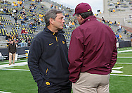 November 21, 2009: Iowa head coach Kirk Ferentz and Minnesota head coach Tim Brewster talk before the Iowa Hawkeyes 12-0 win over the Minnesota Golden Gophers at Kinnick Stadium in Iowa City, Iowa on November 21, 2009.
