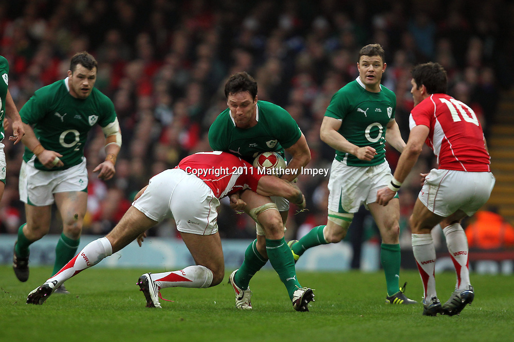 David Wallace of Ireland is tackled by  Mike Phillips of Wales. Wales v Ireland, RBS 6 Nations, Millennium Stadium, Cardiff, Rugby Union, 12/03/2011 © Matthew Impey/Wiredphotos.co.uk. tel: 07789 130 347 email: matt@wiredphotos.co.uk