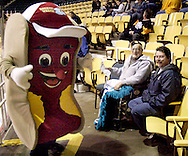 Dreamy Weenie visits with fams in the stands before the Dayton Gems take on the Flint Generals at Hara Arena, Sunday, November 22, 2009.