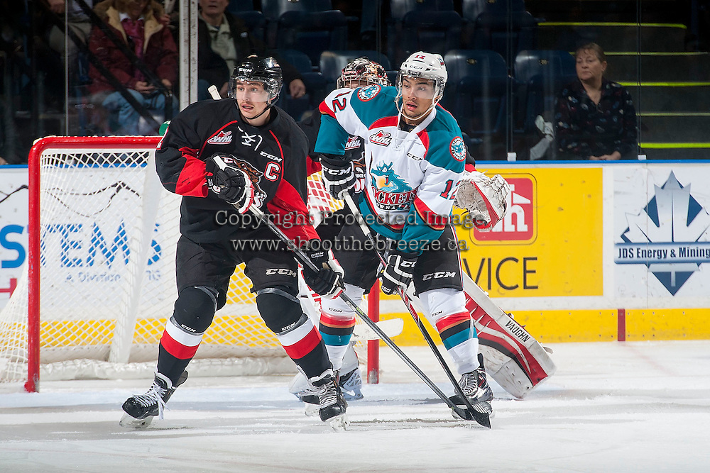 KELOWNA, CANADA - DECEMBER 30: Sam Ruopp #2 of Prince George Cougars stick checks Tyrell Goulbourne #12 of Kelowna Rockets in front of the PG net on December 30, 2014 at Prospera Place in Kelowna, British Columbia, Canada.  (Photo by Marissa Baecker/Shoot the Breeze)  *** Local Caption *** Sam Ruopp; Tyrell Goulbourne;