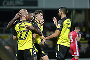 Burton Albion forward Liam Boyce (27) scores his second goal of the game and celebrates with Burton Albion forward Lucas Akins (10) 2-0 during the EFL Cup match between Burton Albion and Morecambe at the Pirelli Stadium, Burton upon Trent, England on 27 August 2019.