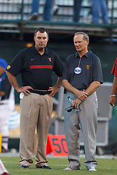 Oct 13, 2011; San Francisco CA, USA;  Southern California Trojans athletic director Pat Haden (right) watches his team before the game against the California Golden Bears at AT&T Park.  Southern California defeated California 30-9. Mandatory Credit: Jason O. Watson-US PRESSWIRE