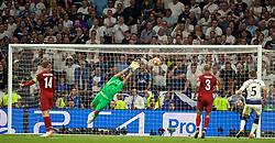 MADRID, SPAIN - SATURDAY, JUNE 1, 2019: Liverpool's goalkeeper Alisson Becker makes a save in the final minutes during the UEFA Champions League Final match between Tottenham Hotspur FC and Liverpool FC at the Estadio Metropolitano. (Pic by David Rawcliffe/Propaganda)