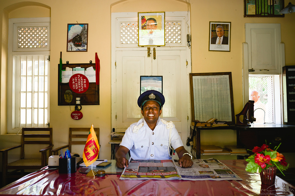 The smiling  Station Master inside his office at a station on the  Kandy to Badulla Railway Line in Sri Lanka.