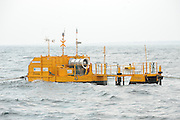 Dr. Peter Heffernan CEO Marine Institute  with Joint Oireachtas Committee on Climate Change and Energy Security  from left Ned O Sullivan, Simon Coveney, Ciaran Cuffe, Chairman Sean Barrett, Liz McManus, Paudie Coffey and Andrew Doyle on board  Glor na Farraige  during a visit to the ocean energy wave power test site at An Spideal, Co. Galway.Photo:Andrew Downes. Photo issued with compliments, no reproduction fee..