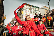 Drummers with the Chinese Restaurant Association float behind them.