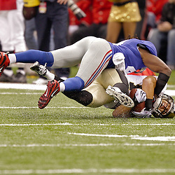 2009 October 18: New Orleans Saints wide receiver Lance Moore (16) is tackled after a catch by New York Giants safety C.C. Brown (41) during a 48-27 win by the New Orleans Saints over the New York Giants at the Louisiana Superdome in New Orleans, Louisiana.
