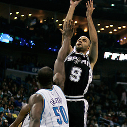Mar 01, 2010; New Orleans, LA, USA; San Antonio Spurs guard Tony Parker (9) shoots over New Orleans Hornets center Emeka Okafor (50) during the first half at the New Orleans Arena. Mandatory Credit: Derick E. Hingle-US PRESSWIRE