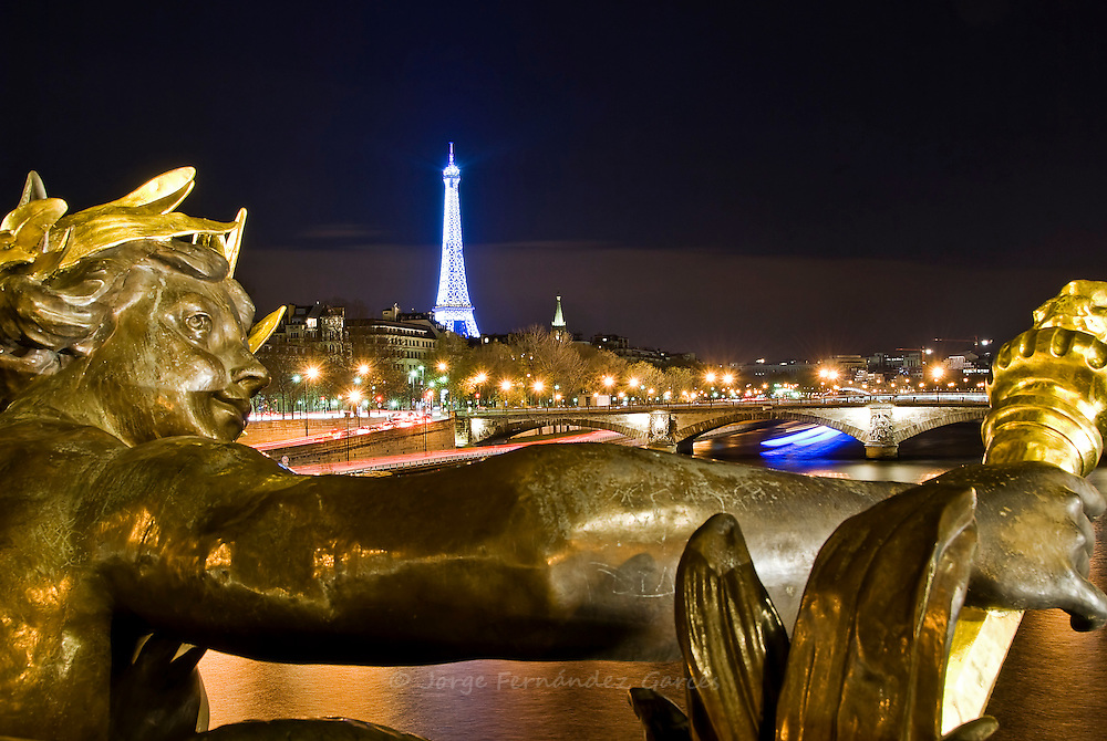 View of the Eiffel Tower at night from the Alexandre III bridge, Paris, France, Europe