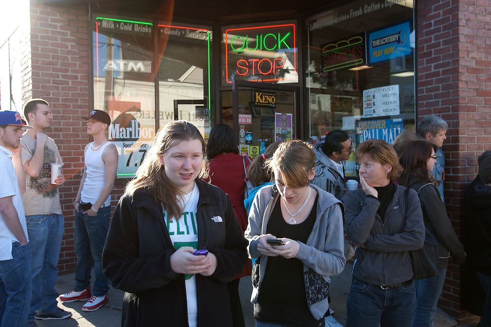 Newton, MA 03/17/2011.Mary Cugini, at left, and Jailee Klein watch as police investigate a shooting at Cristofori Jewelers in Newton on Thursday afternoon..Alex Jones / For The Newton TAB