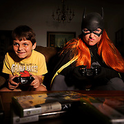 Teri Christine playing the role of Batgirl, right, poses with her son Owen, 7, as they pretend to play video games Wednesday, July 1, 2015 in Tampa. CHRIS URSO/STAFF