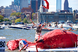 """Red Bull Flugtag, Camden Waterfront, NJ USA - September 15, 2012;.33 teams compete in the second edition of the Philly Red Bull Flug Tag. Thousands came out on both sides of the river to see handmade crafts attempt to fly. Team """"New Kids on the Dock"""" from Philadelphia, PA took the 1st prize for covered distance....The giant lobster of team """"New Kids on the Dock"""" is one of the only crafts to make some distance..."""