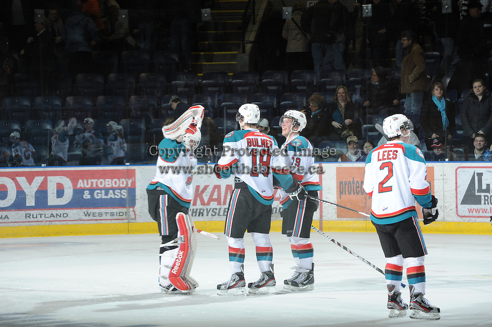 KELOWNA, CANADA - FEBRUARY 18: The Kelowna Rockets  celebrate the win via shoot out against the  Red Deer Rebels at the Kelowna Rockets on February 18, 2012 at Prospera Place in Kelowna, British Columbia, Canada (Photo by Marissa Baecker/Shoot the Breeze) *** Local Caption ***