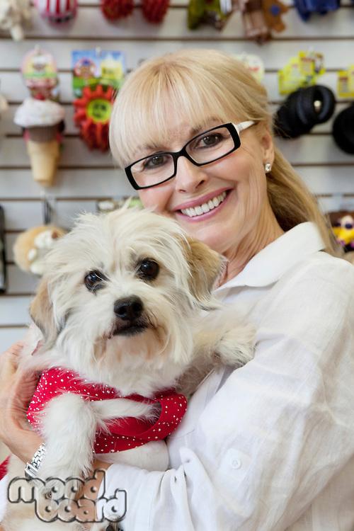 Portrait of senior pet owner shop with dog