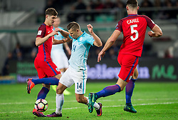Roman Bezjak of Slovenia between John Stones of England and Gary Cahill of England during football match between National teams of Slovenia and England in Round #3 of FIFA World Cup Russia 2018 Qualifier Group F, on October 11, 2016 in SRC Stozice, Ljubljana, Slovenia. Photo by Vid Ponikvar / Sportida