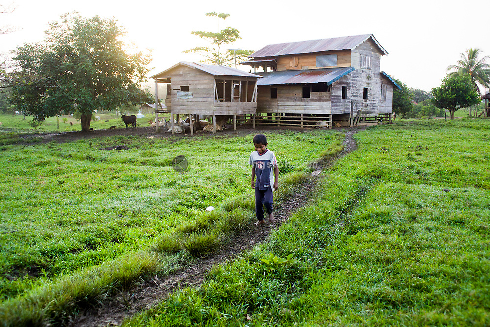 A young Miskito boy walks on a muddy path in Krin Krin, Nicaragua.