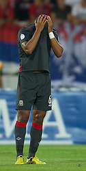 NOVI SAD, SERBIA - Tuesday, September 11, 2012: Wales' Ashley Williams looks dejected as Serbia score the fifth goal during the 2014 FIFA World Cup Brazil Qualifying Group A match at the Karadorde Stadium. (Pic by David Rawcliffe/Propaganda)