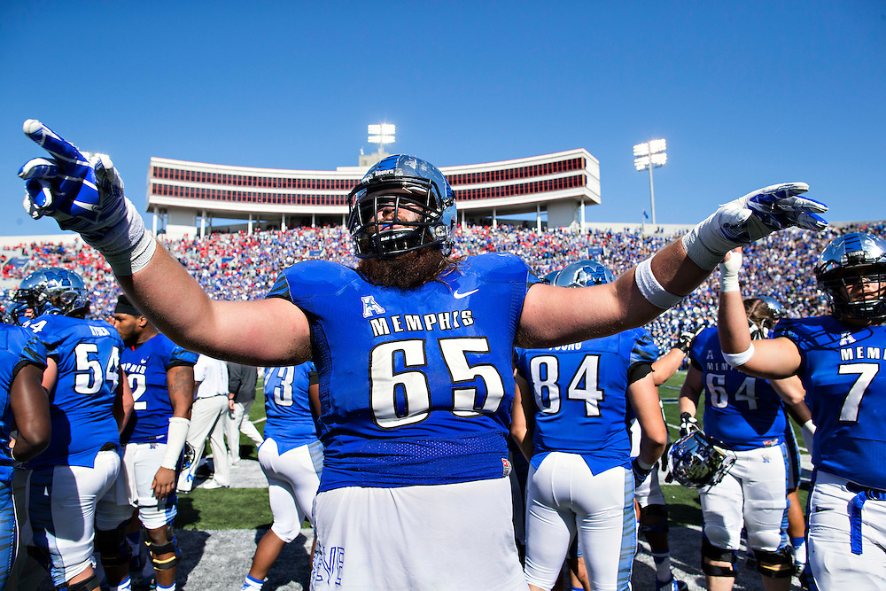 MEMPHIS, TN - OCTOBER 17:  Christopher Roberson #65 of the Memphis Tigers celebrates at the end of a game against the Ole Miss Rebels at Liberty Bowl Memorial Stadium on October 17, 2015 in Memphis, Tennessee.  The Tigers defeated the Rebels 37-24.  (Photo by Wesley Hitt/Getty Images) *** Local Caption ***  Christopher Roberson